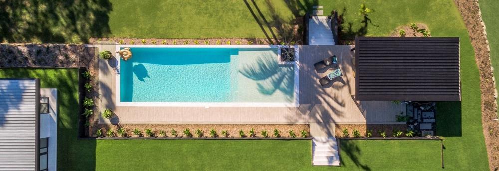 sarah_waller_design_hero_7_doonan_glasshouse_pool_drone_image