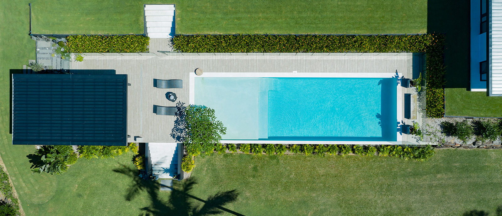 sarah_waller_design_hero_7_doonan_glasshouse_pool_drone_image
